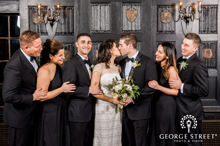 lovable group in front of vintage shelves wedding photography
