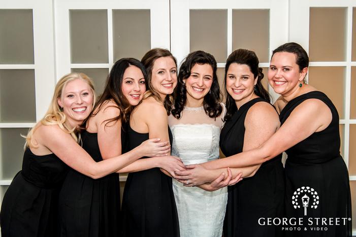 pretty bride and bridesmaids posing near hotel room door wedding photography