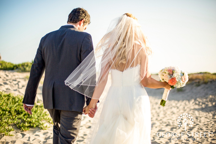 coronado community center cheerful bride and groom walking on beach san diego wedding photos