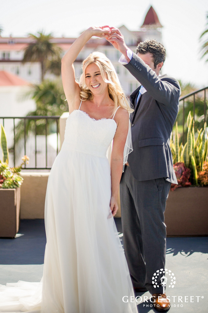coronado community center happy couple dance on terrace san diego wedding photos