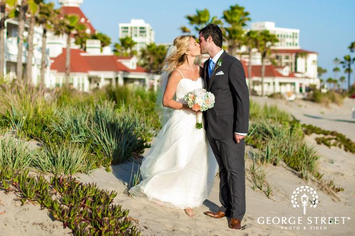 coronado community center passionate couple infront beach resort san diego wedding photos
