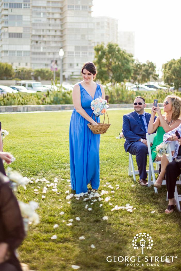 coronado community center san diego happy bridemaid walking down the aisle wedding photos