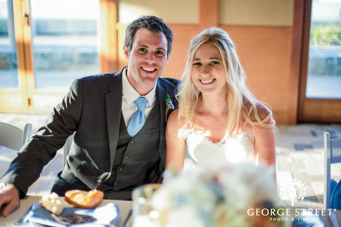 coronado community center sweet couple on wedding reception table san diego wedding photos
