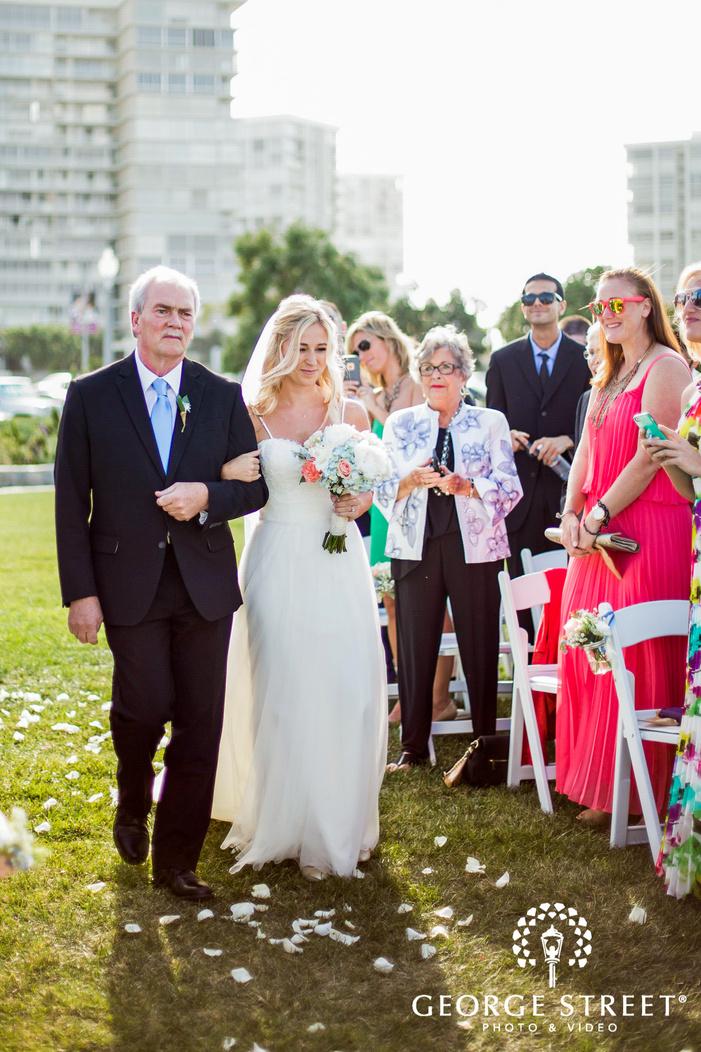 happy bride and father walking down the aisle coronado community center san diego wedding photos