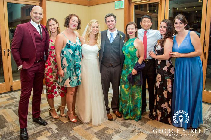 happy couple and guest in reception hall coronado community center san diego wedding photos