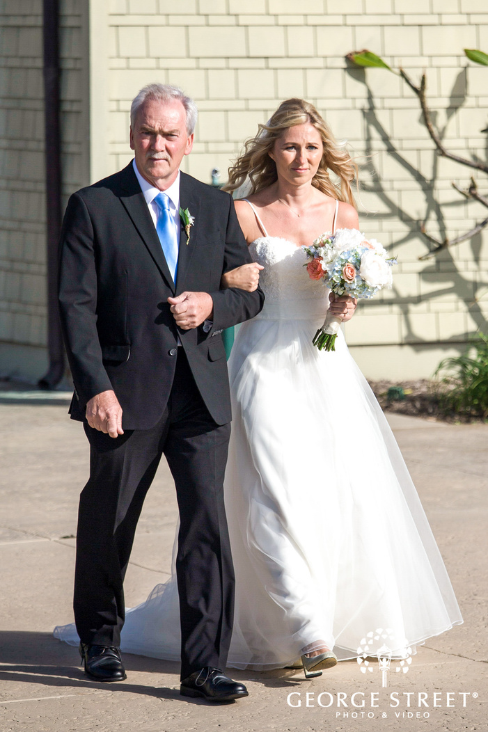 joyous bride and father walking towards the aisle coronado community center san diego wedding photos