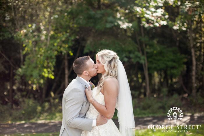pickering barn seattle rustic wedding outdoor bride and groom kiss