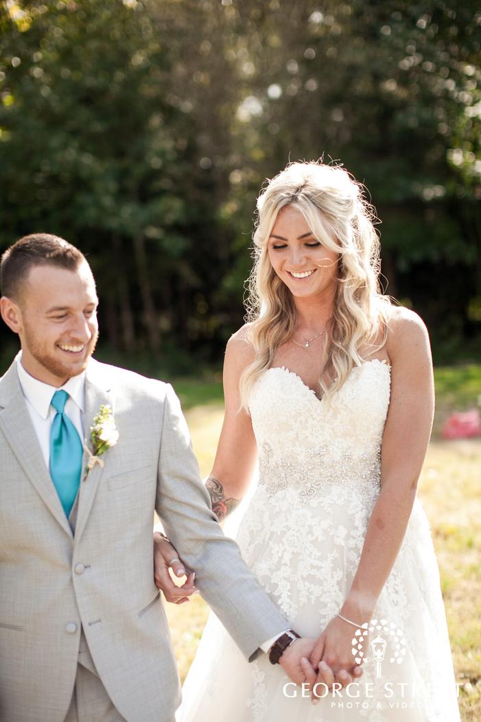 pickering barn seattle rustic wedding outdoor bride and groom portraits candid