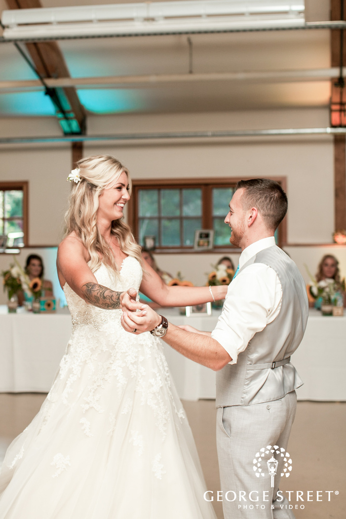 pickering barn seattle wedding reception bride and groom first dance candid