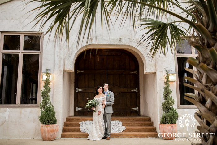 charming bride and groom at entrance steps wedding photography