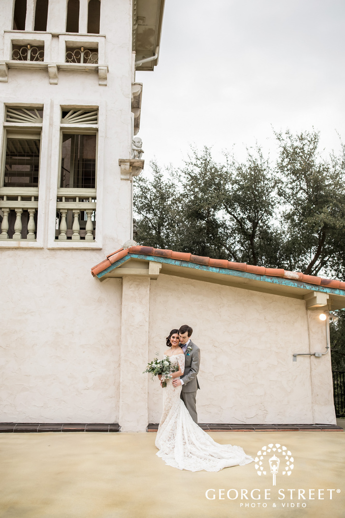 charming bride and groom in front of villa antonia in austin