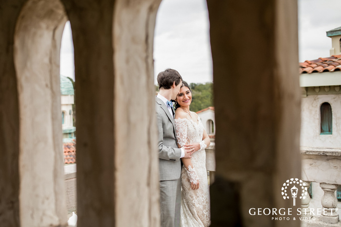 lovable bride and groom near arch wall wedding photography