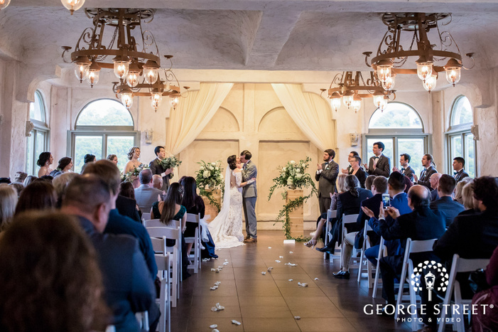 romantic bride and groom first kiss at villa antonia in austin