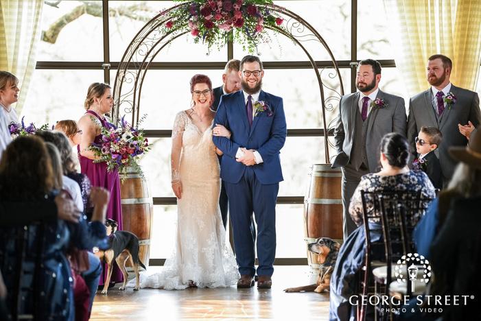 cheerful bride and groom ceremony exit wedding photo