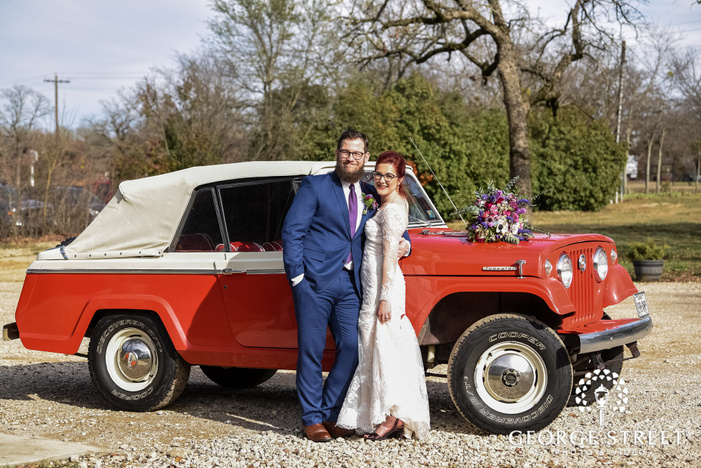 happy bride and groom in front red car wedding photography