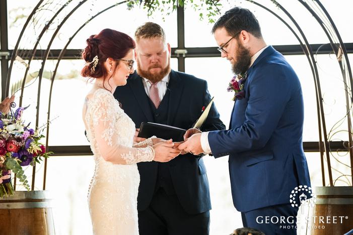 happy bride and groom ring exchange ceremony wedding photo