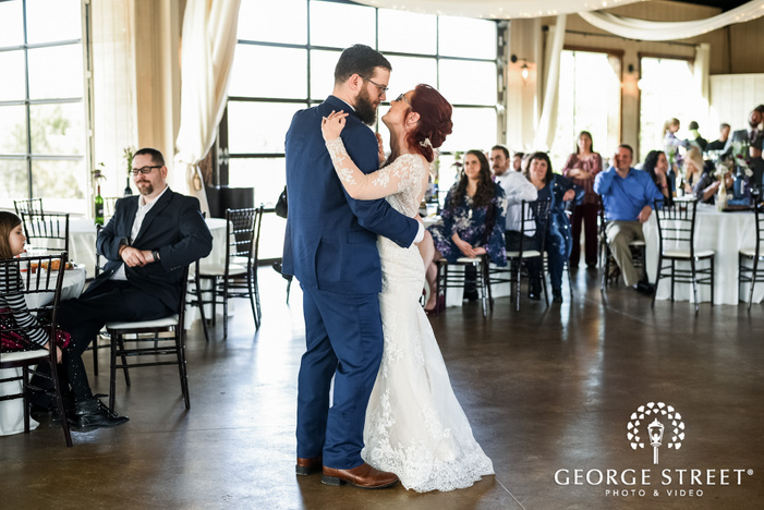 joyful bride and groom first dance at lost oak winery in dallas fort worth