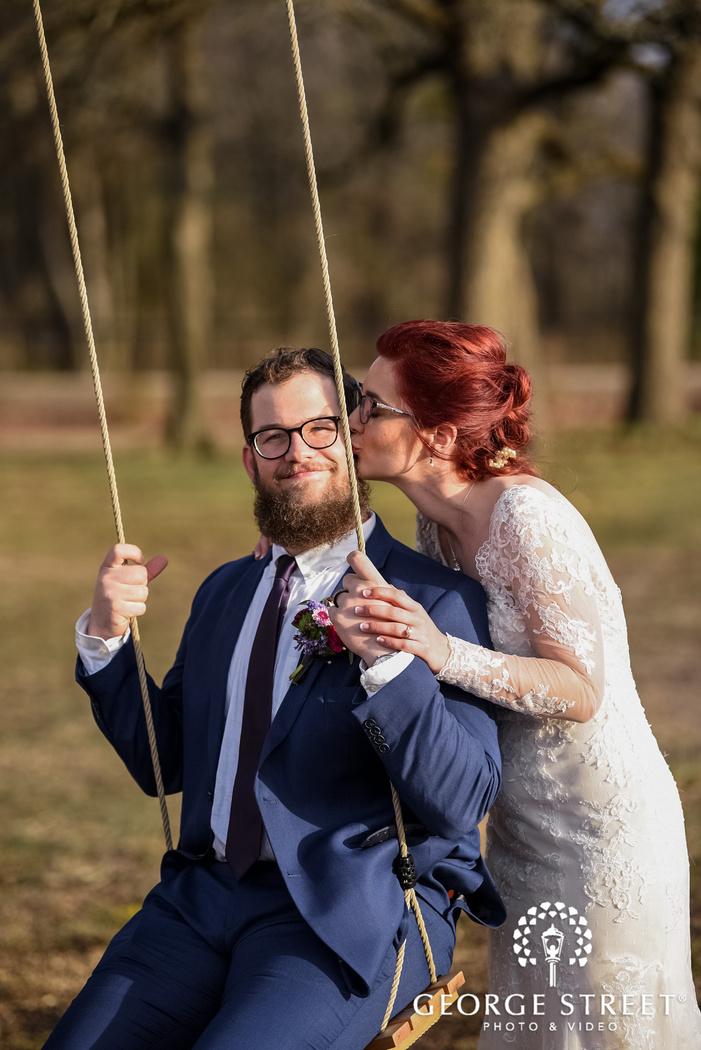 loveable couple on swing wedding photo