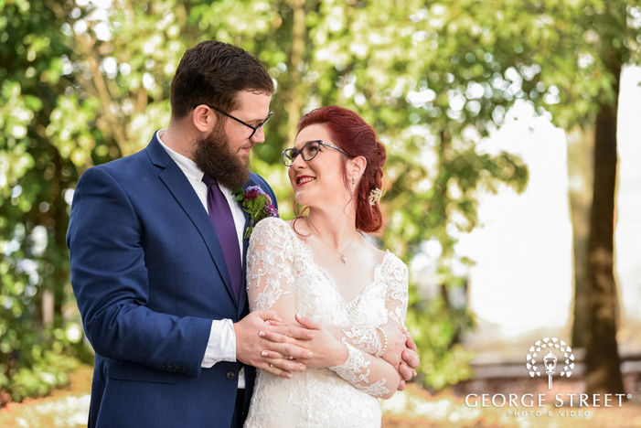lovely bride and groom in greenery wedding photo