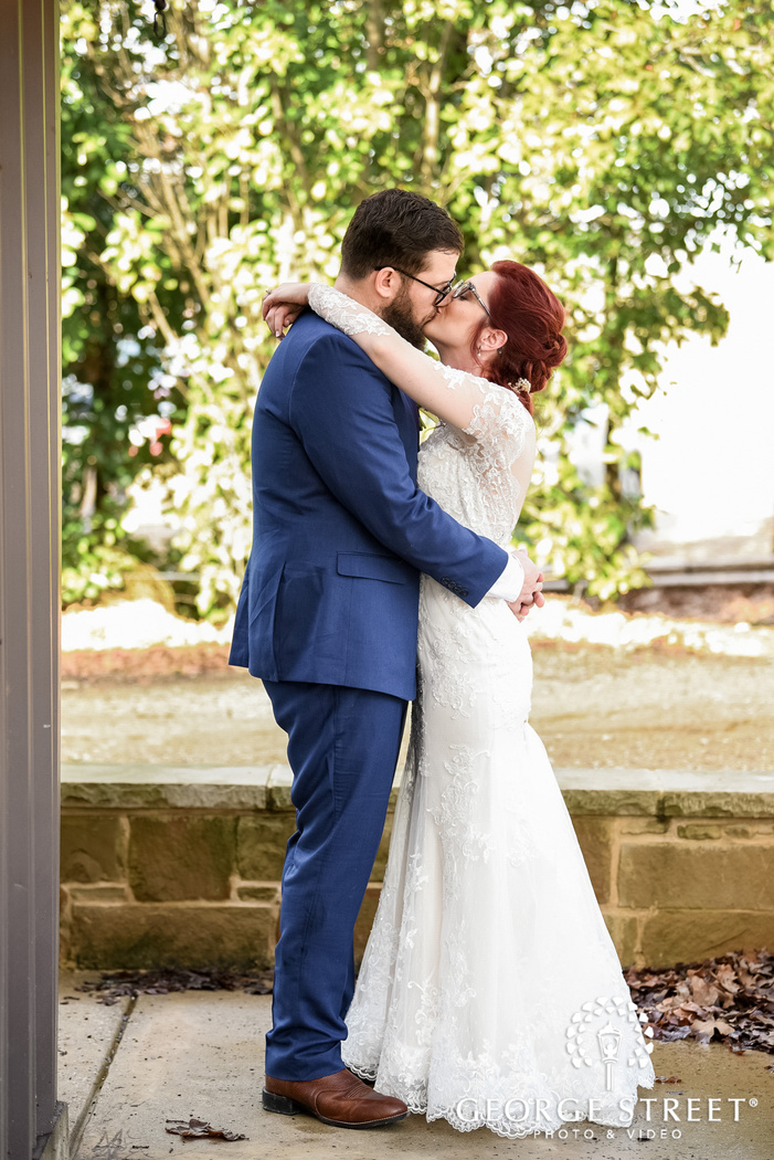 passionate couple in lobby wedding photo