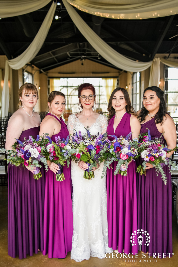 pretty bride and bridemaids in hall at lost oak winery in dallas fort worth