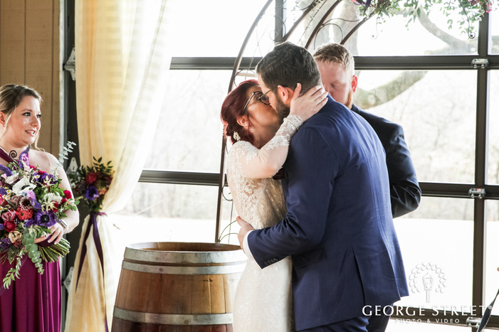 romantic bride and groom first kiss wedding photo