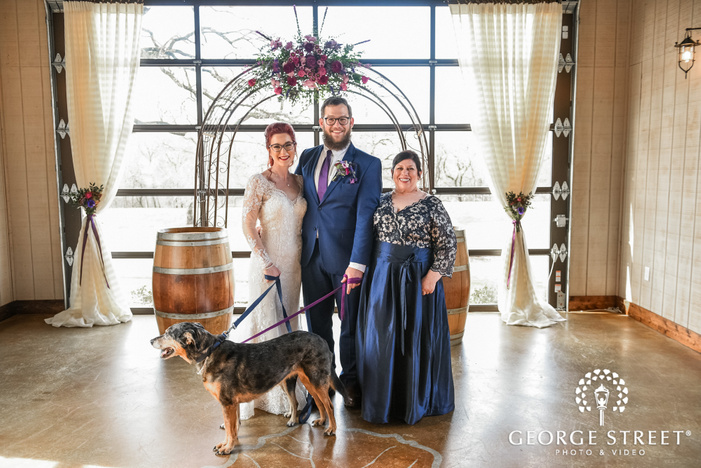 sweet couple and parents near altar wedding photo