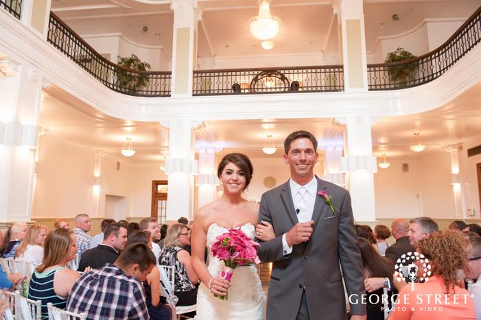 bride and groom exit indoor wedding ceremony