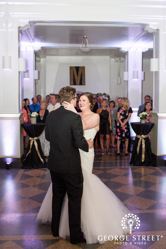 happy bride and groom first dance