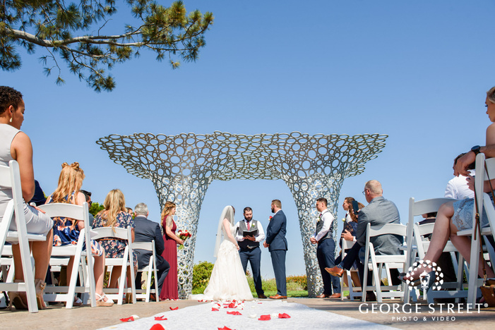 beautiful bride and groom taking wedding vows at tom hams lighthouse in san diego