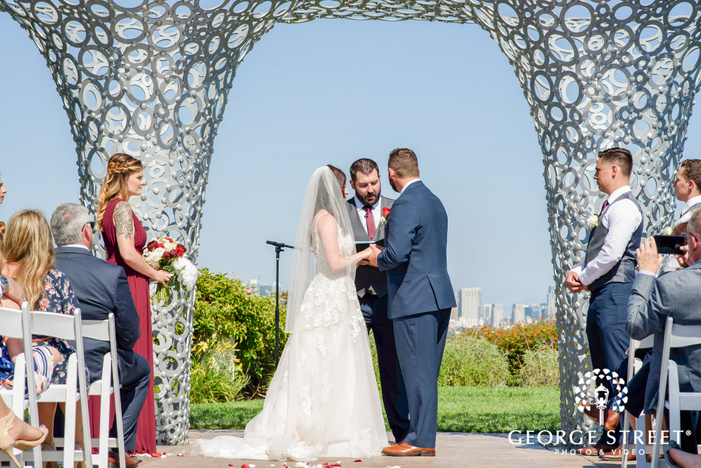 beautiful bride and groom taking wedding vows outdoor wedding photo
