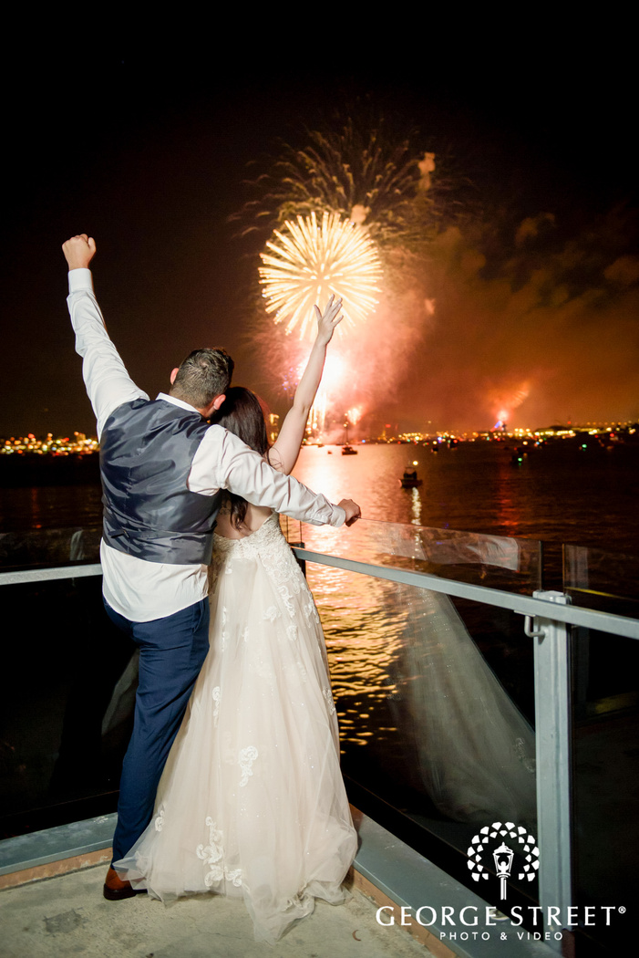 cheerful couple watching fireworks outdoor wedding photo