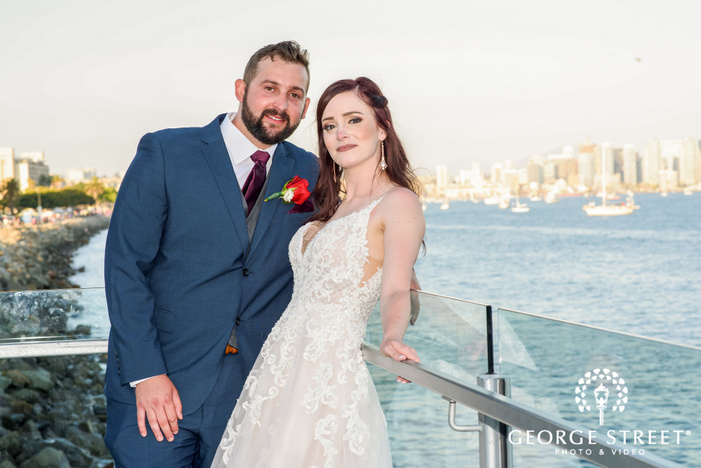 gorgeous bride and groom near seaside at tom hams lighthouse in san diego