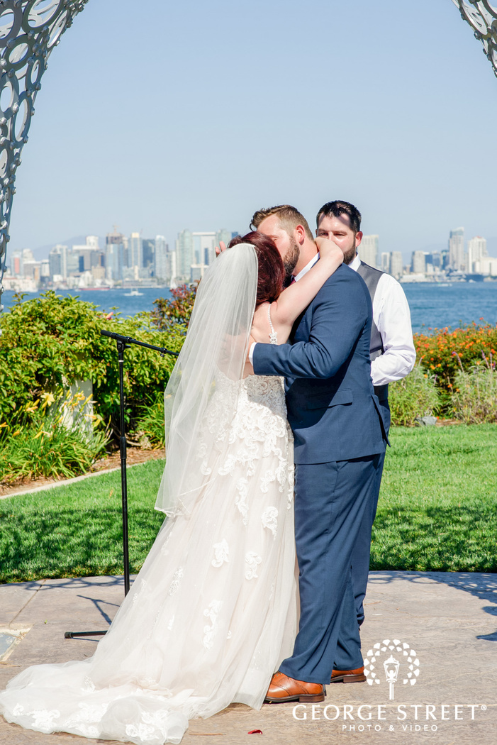 gorgeous couple first kiss at ceremony wedding photo