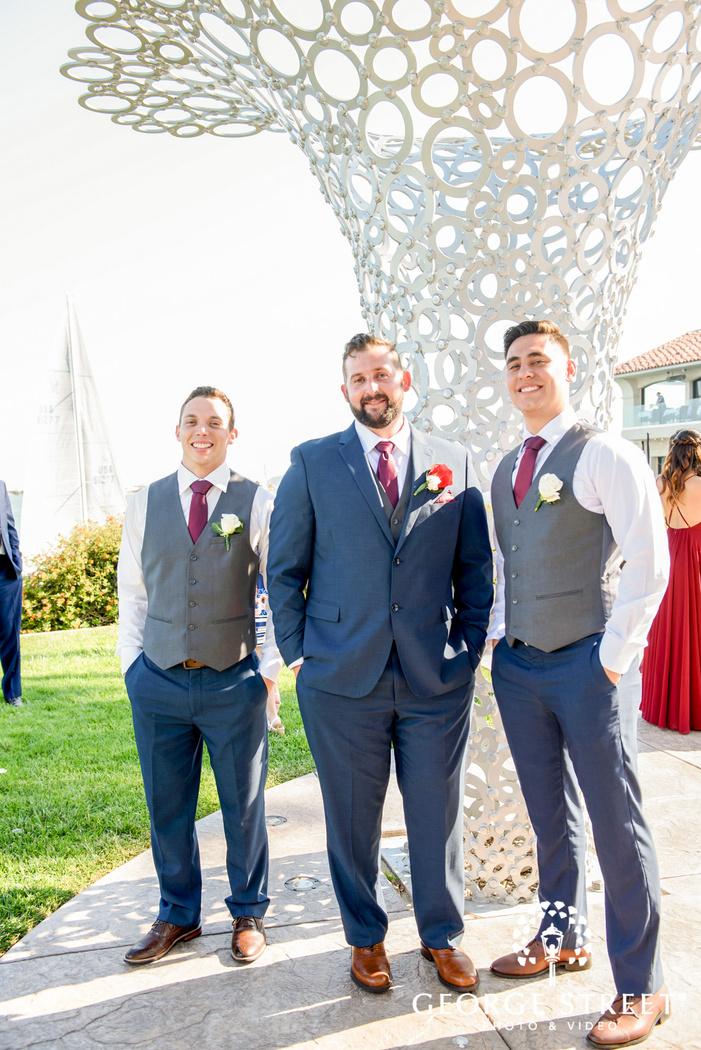 handsome groom with groomsmen in garden wedding photo