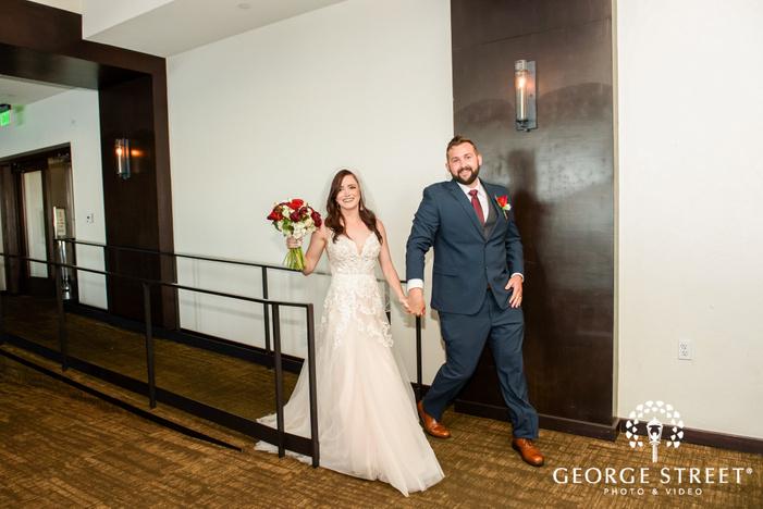 happy couple entering reception venue wedding photo