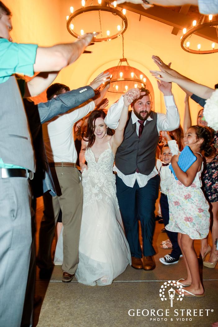 happy couple exiting reception ceremony wedding photo