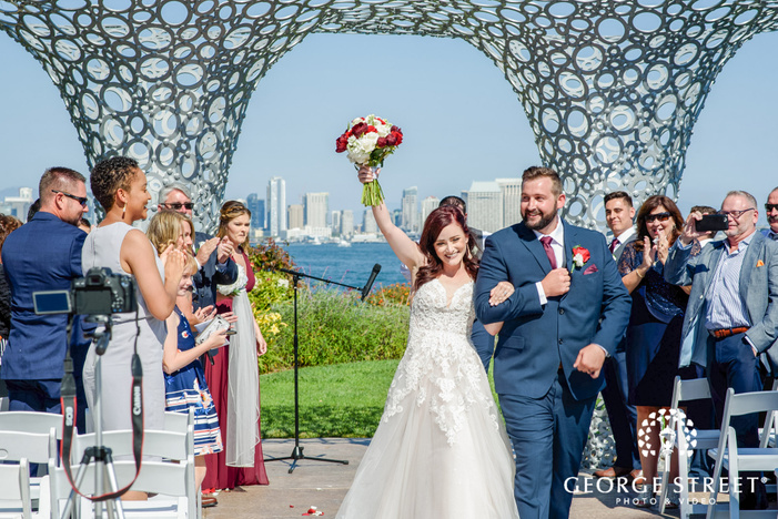 lovely bride and groom exiting ceremony venue wedding photo