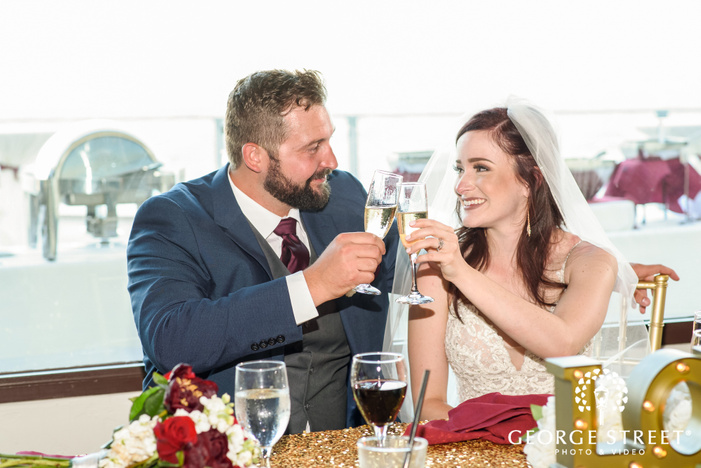 lovely couple having a toast at their reception ceremony wedding photo