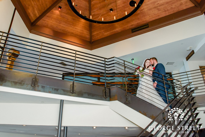 pretty bride and groom in stairs at tom hams lighthouse in san diego