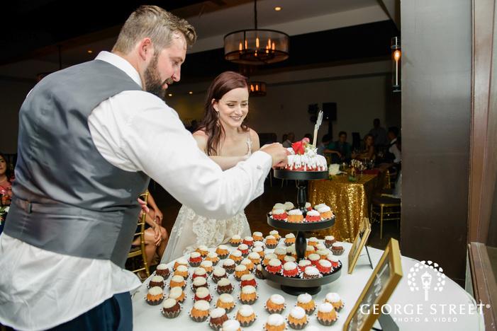 pretty bride and groom wedding cake cutting ceremony wedding photography