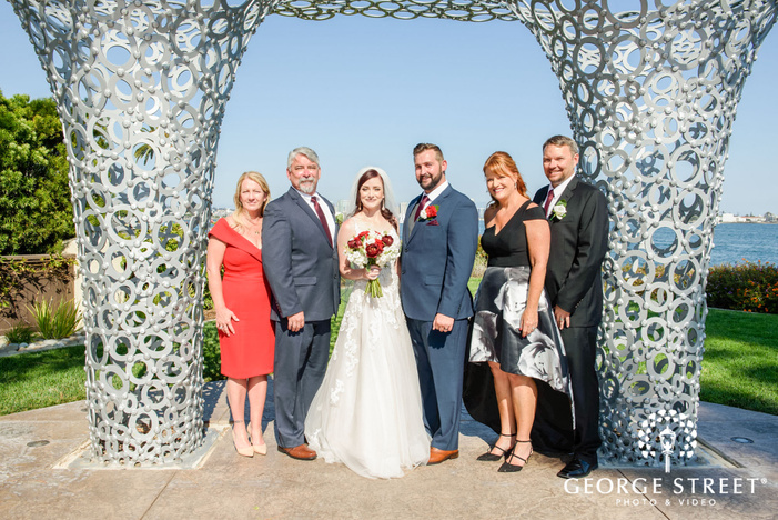 pretty bride with guests outdoor wedding photography