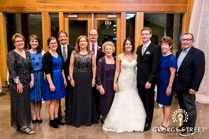 adorable couple and guests in reception hall wedding photo