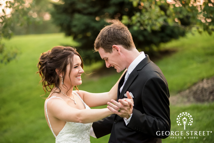 blissful bride and groom in lawn wedding photo