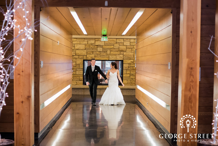 cheerful bride and groom reception entrance at vadnais heights commons in minneapolis