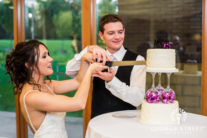 cute bride and groom cake cutting ceremony wedding photography