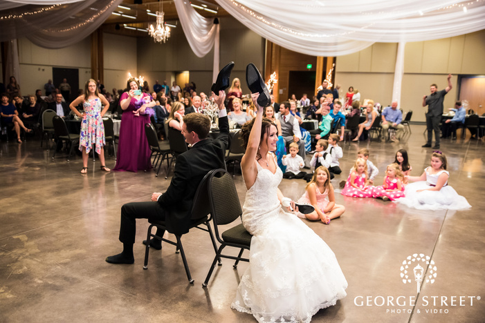 happy bride and groom during reception game wedding photo