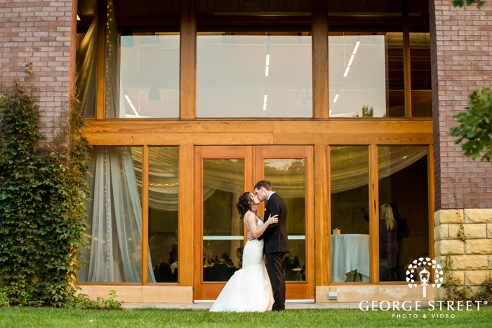 lovely bride and groom in front of reception hall wedding photo