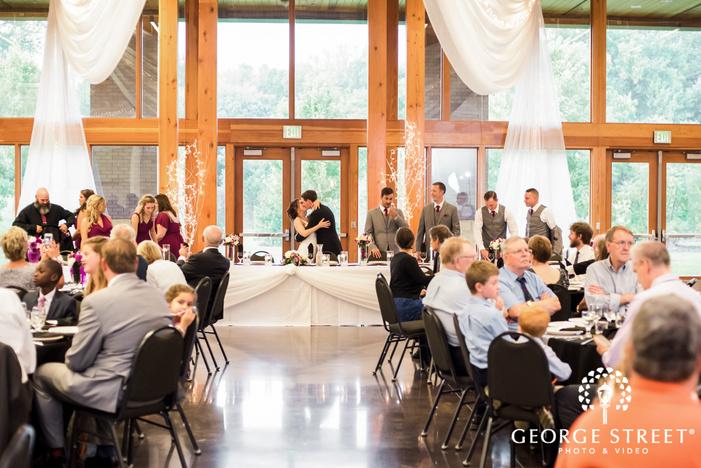 loving bride and groom in reception hall wedding photo