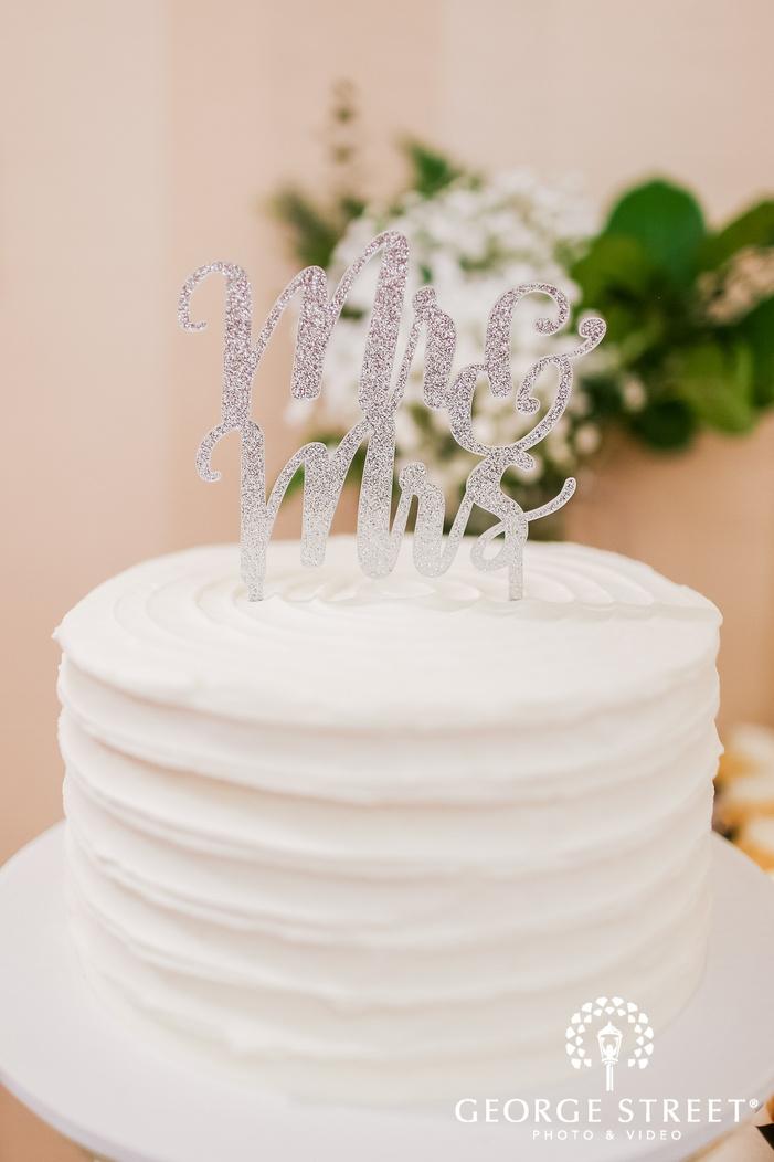 adorable wedding cake with customized topping wedding photo